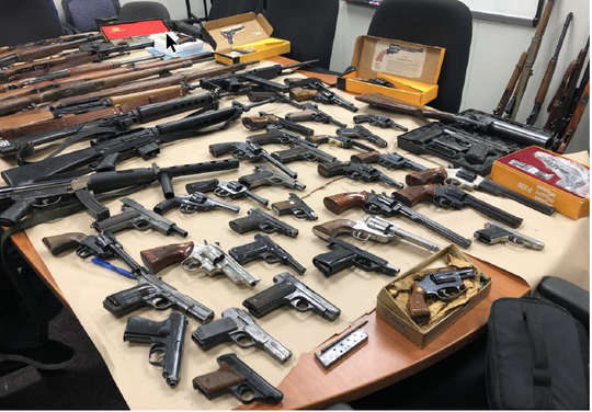 Guns found in the search of a woman on probation in Monterey.