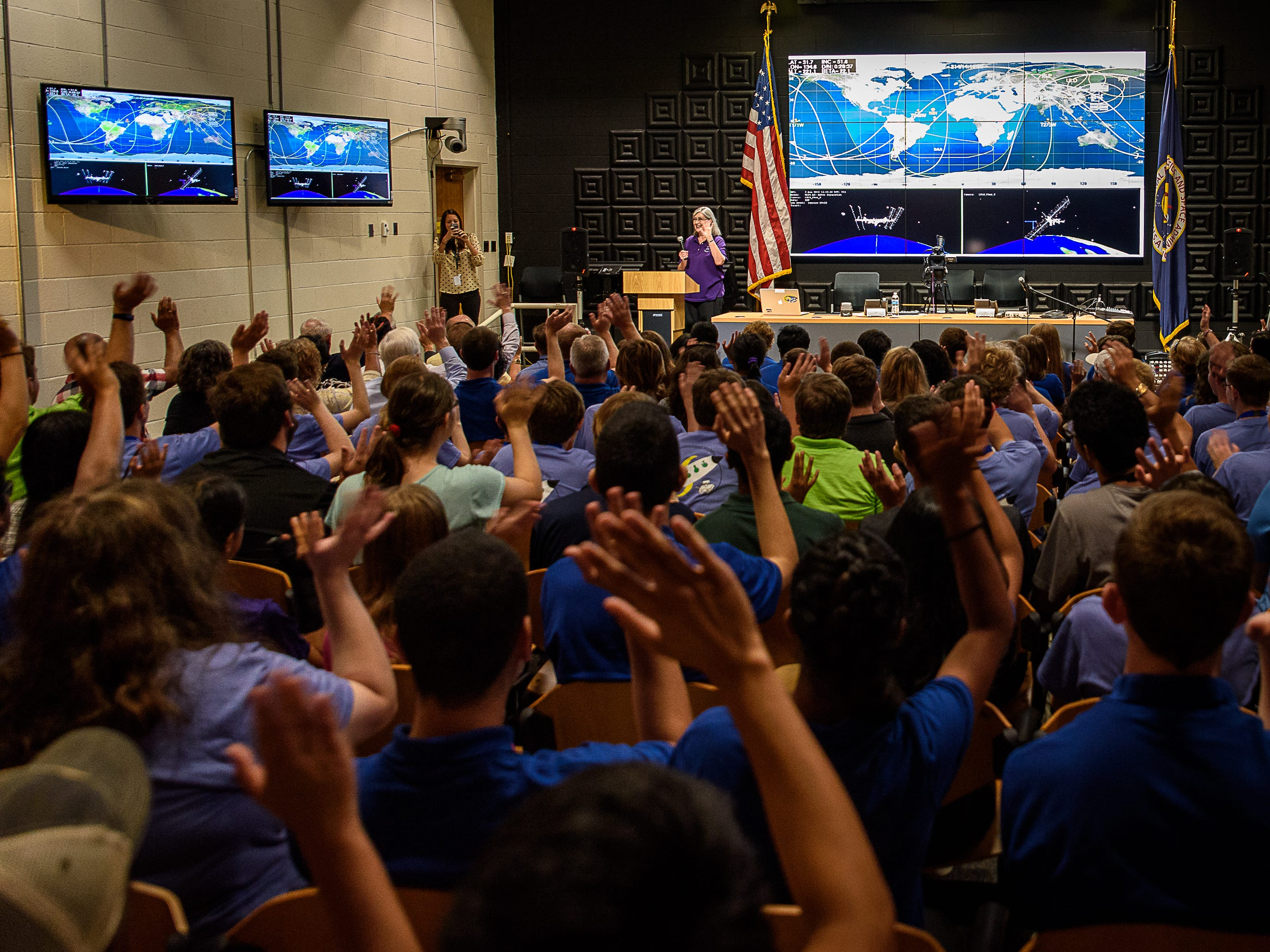 The entire crowd waves for an Instagram photo-op before students spoke with astronauts aboard the International Space Station as part of NASA's Year of Education on Station on Aug. 2, 2018.