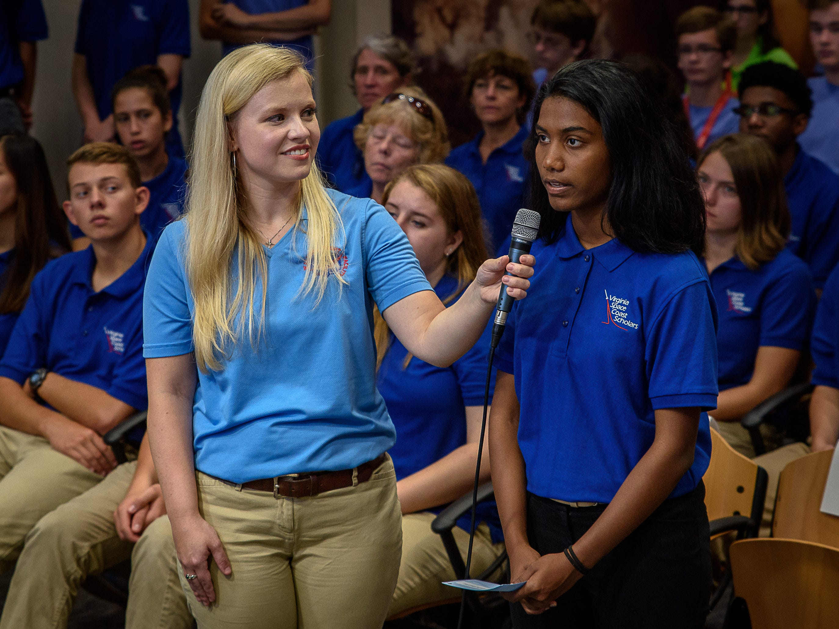 Wallops Facilitator Victoria Danna (left) and a student from Virginia Space Coast Scholars ask astronaut Andrew Feustal a question. Students at Wallops Flight Facility spoke to the crews aboard the International Space Station as part of NASA's Year of Education on Station program on Aug. 2, 2018.