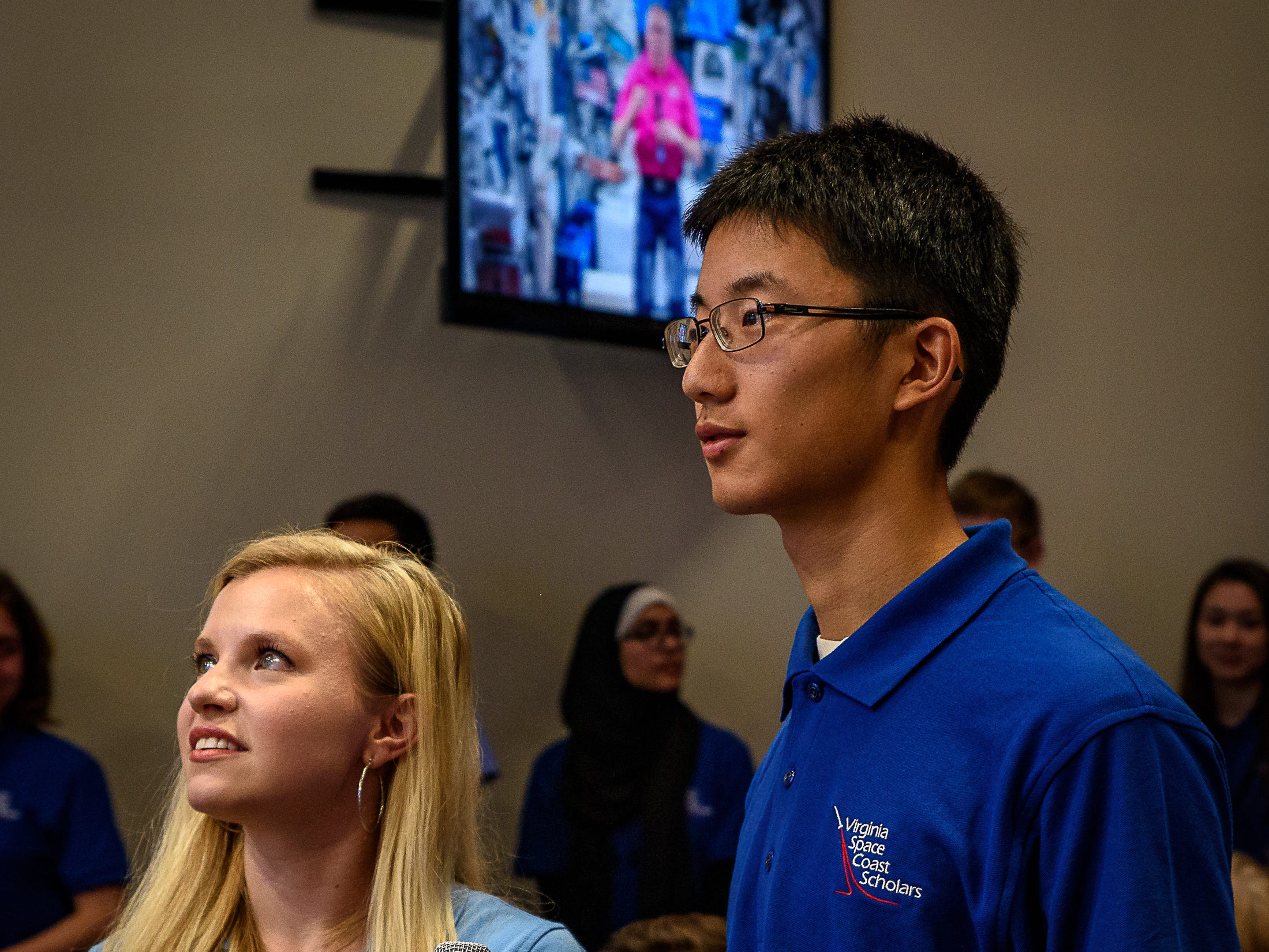 Wallops Facilitator Victoria Danna, (left) and a student from Virginia Space Coast Scholars, talk to astronaut Andrew Feustal. Students at Wallops Flight Facility spoke to crews while aboard the International Space Station as part of NASA's Year of Education on Station program on Aug. 2, 2018.