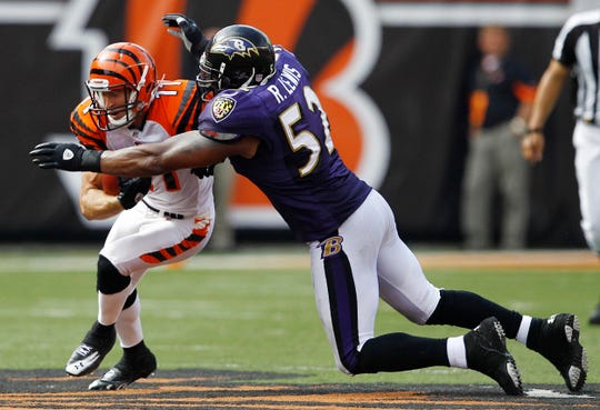 Sept 19, 2010; Cincinnati, OH, USA; Baltimore Ravens linebacker Ray Lewis (52) brings down the Cincinnati Bengals wide receiver Jordan Shipley (11) at Paul Brown Stadium. The Bengals defeated the Ravens 15-10. Mandatory Credit: Frank Victores-USA TODAY Sports