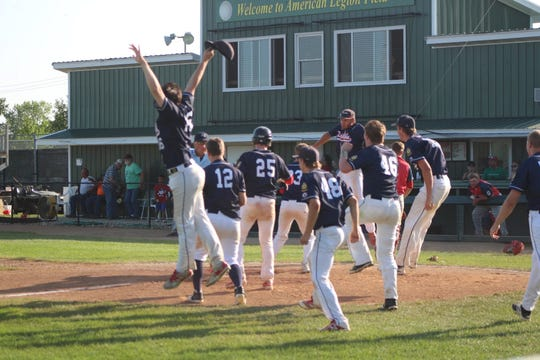 The Dell Rapids Legion baseball team reacts to Matt Gillogly's walk-off homerun to win the state title.