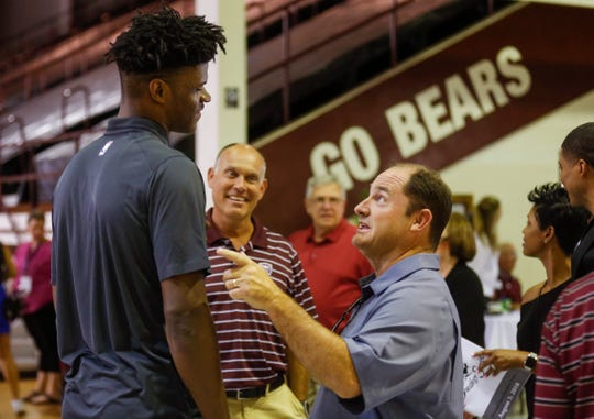 Recent MSU alum and Indiana Pacers rookie Alize Johnson, left, talks with MSU athletic director Kyle Moats during the Sneaker Soiree at Hammons Student Center on Friday, Aug. 3, 2018.