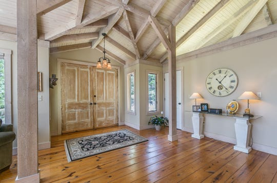 Jack Rhoads fell in love with the house when he walked in. The unusual beamed ceilings and natural light pulled at him.
