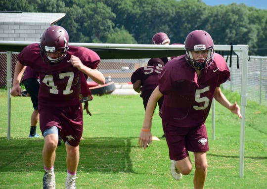 Stuarts Draft football players go through an agility drill during practice in Stuarts Draft, Va., on Thursday, Aug. 2, 2018.