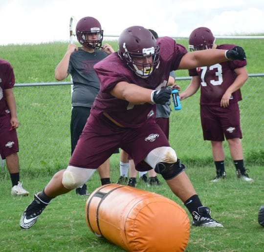 Stuarts Draft senior lineman Justin Brown participates in a drill during football practice in Stuarts Draft, Va., on Thursday, Aug. 2, 2018.
