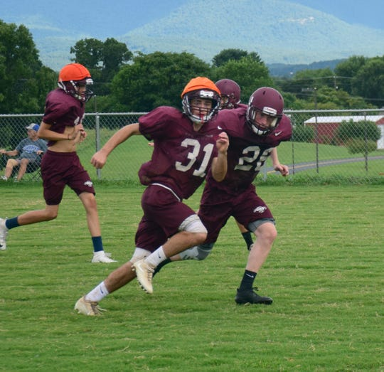 Stuarts Draft senior defensive back Jesse McCauley, right, covers a teammate during a drill at football practice in Stuarts Draft, Va., on Thursday, Aug. 2, 2018.