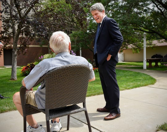 Senate candidate Richard Painter talks with a resident Friday, Aug. 3, at St. Benedict's Senior Community in St. Cloud.