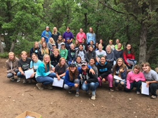LDS young women gather at camp.