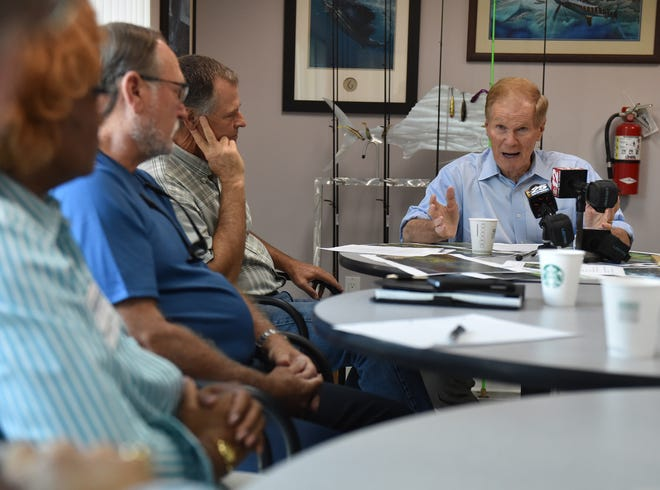 U.S. Sen. Bill Nelson (right) speaks with more than a dozen local citizens and leaders about the toxic algae outbreak during a roundtable meeting on Friday, August 3, 2018, at the Florida Sportsman Magazine at 2700 Kanner Highway in Stuart.  To see more photos, go to TCPalm.com