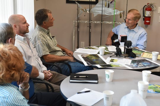 U.S. Sen. Bill Nelson speaks with more than a dozen local citizens and leaders about the toxic algae outbreak during a roundtable meeting on Friday, August 3, 2018, at Florida Sportsman Magazine, 2700 Kanner Highway in Stuart.