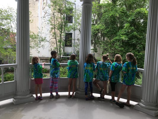 Girl Scouts On Balcony