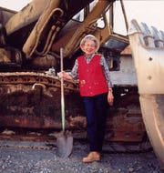 Archaeologist Roberta Greenwood poses with a tool of her trade in this undated photo.