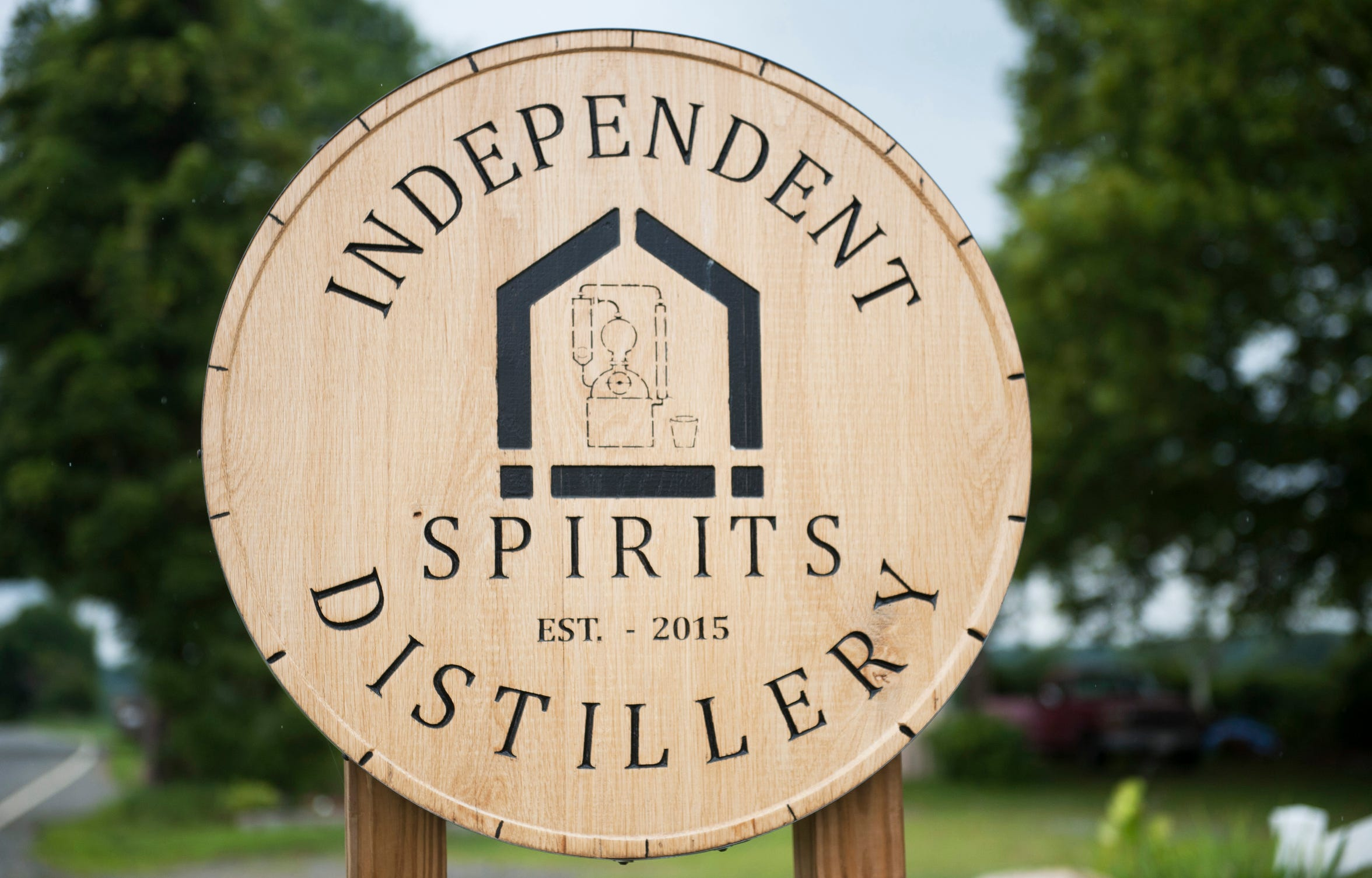 A sign sits outside of Independent Spirits Distillery in Woolwich Township.