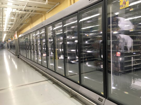 The refrigerated and frozen food cases at the Walmart in White Plains were empty, as shoppers took advantage of prices marked down 75% Aug. 3, 2018. The store closes its doors on Aug. 10th.