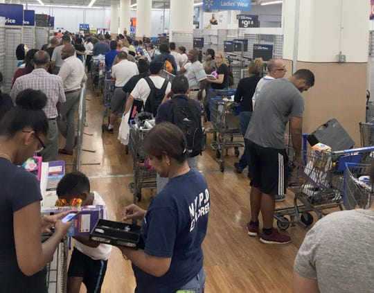 With remaining products marked down 75%, bargain hunters scoured the aisles at the Walmart in White Plains Aug. 3, 2018. The store closes its doors on Aug. 10th.