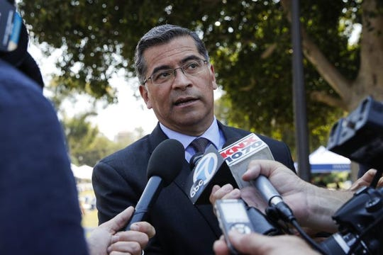 California Attorney General Xavier Becerra talks to reporters after a news conference at University of California, Los Angeles Thursday, Aug. 2, 2018.