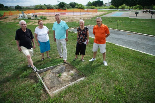 Bon Ayre residents (from left) Frank Donnelly, Marvadell Zeeb, Milton Stroup, Joan Peculski and Tony DeFeo next to a horseshoe pit in disrepair and a pool that was supposed to be completed Memorial Day.