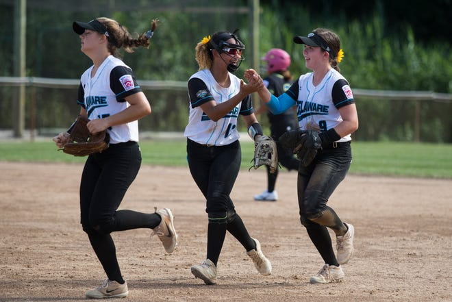 Delaware's Kayla Evans, 13, celebrates with Jordyn Difava, 9, after defeating Asia-Pacific 8-4 in their last pool play game in the Little League Softball World Series Thursday afternoon.