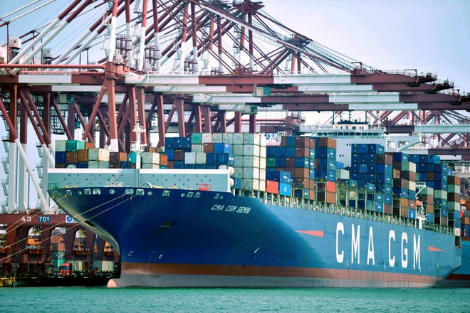 FILE - In this July 6, 2018, file photo, a container ship is docked at a port in Qingdao, in eastern China's Shandong Province. The Trump administration is proposing raising planned taxes on $200 billion in Chinese imports to 25 percent from 10 percent, turning up the pressure on Beijing in a trade war between the world's two biggest economies.