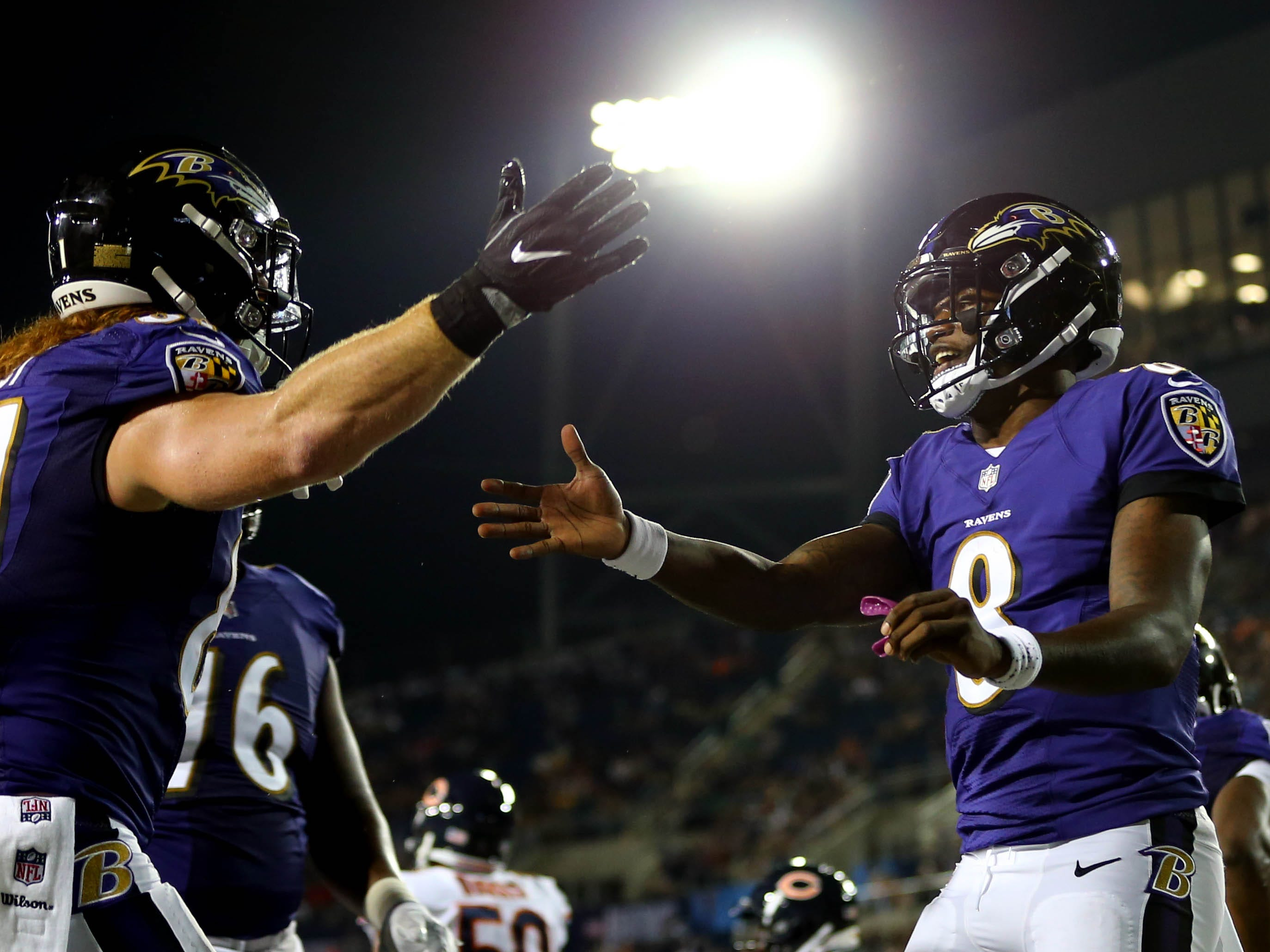 Baltimore Ravens tight end Hayden Hurst (left) celebrates scoring a touchdown with quarterback Lamar Jackson (8) against the Chicago Bears in the second half at Tom Benson Hall of Fame Stadium.