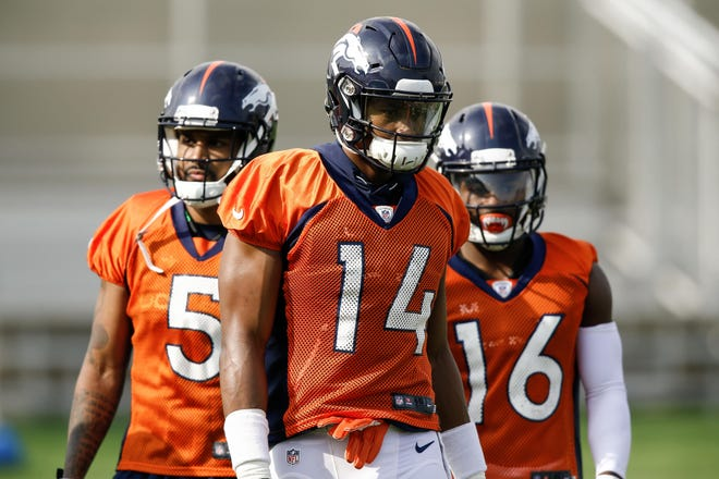 Denver Broncos wide receivers Courtland Sutton (14) and Corey Brown (5) and Isaiah McKenzie (16) during the first day of training camp at Paul D. Bowlen Memorial Broncos Centre.