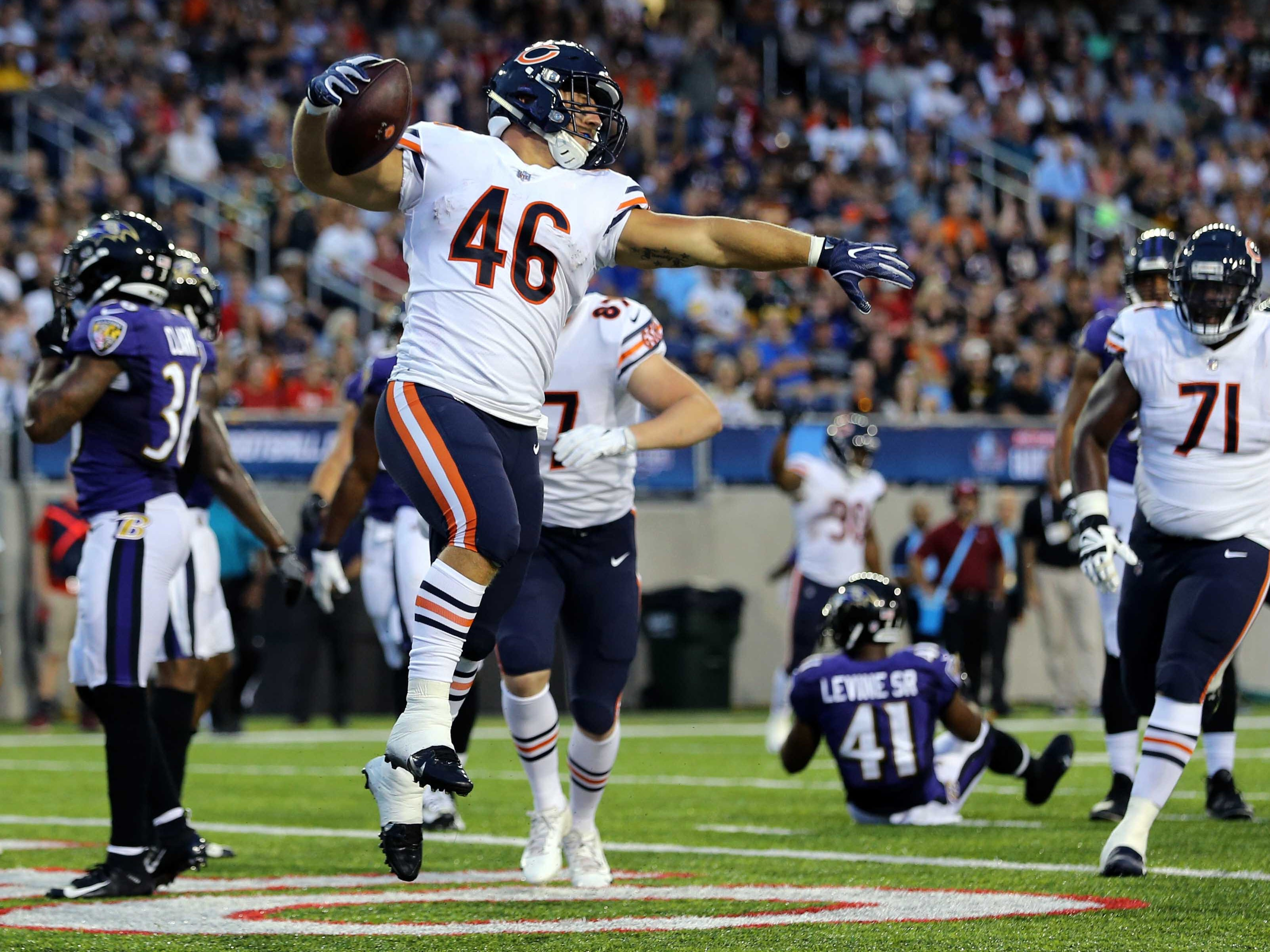 Chicago Bears fullback Michael Burton (46) reacts to scoring a touchdown against the Baltimore Ravens in the first half at Tom Benson Hall of Fame Stadium.