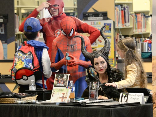 Sybil Todd of White Knight Cosplay at her booth during the Anderson County Library Electric City Comicon in Anderson on Saturday.