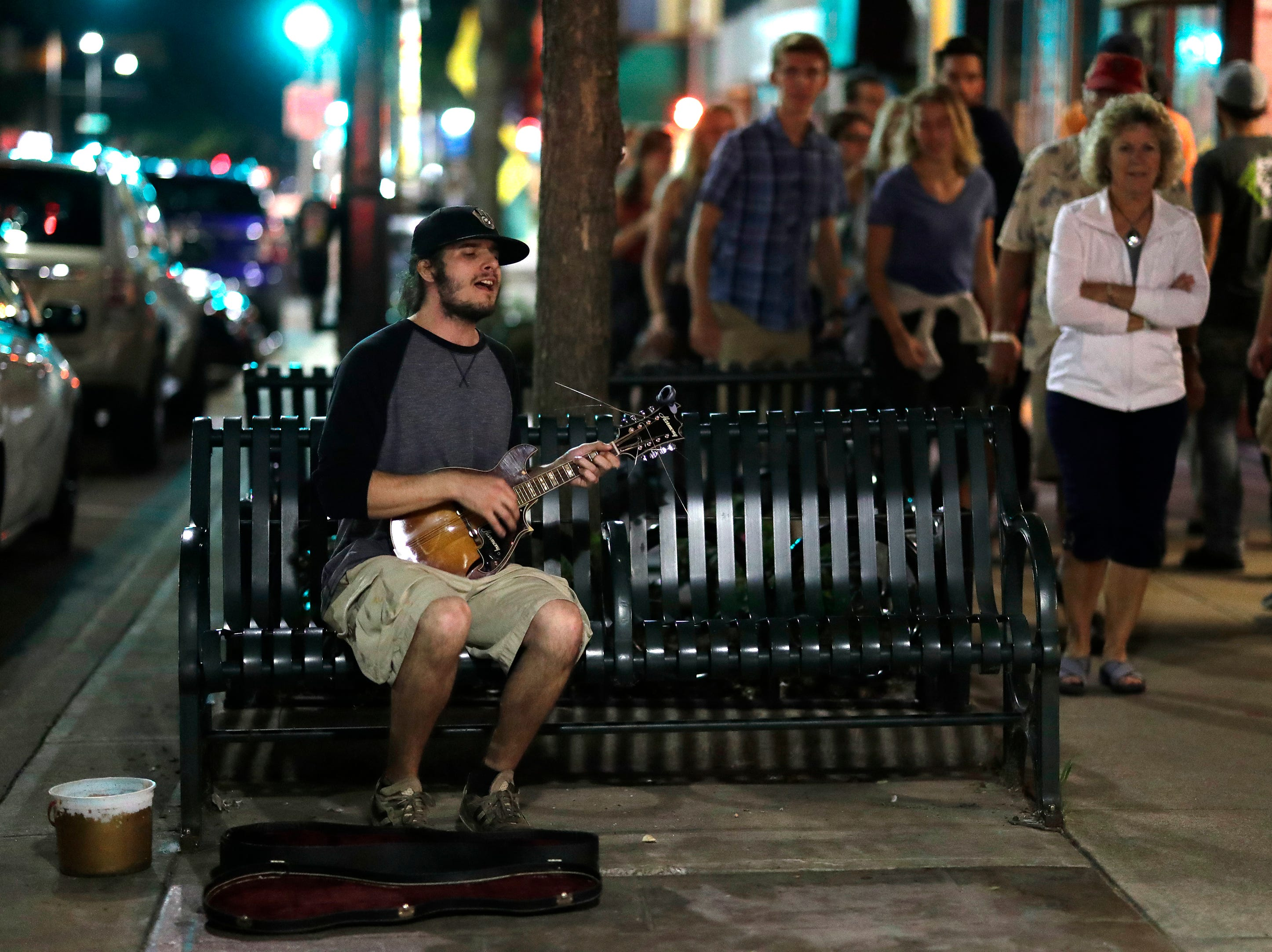 Robert Golla of Appleton plays the mandolin along College Avenue during the Mile of Music Friday, August 3, 2018, in Appleton, Wis.  