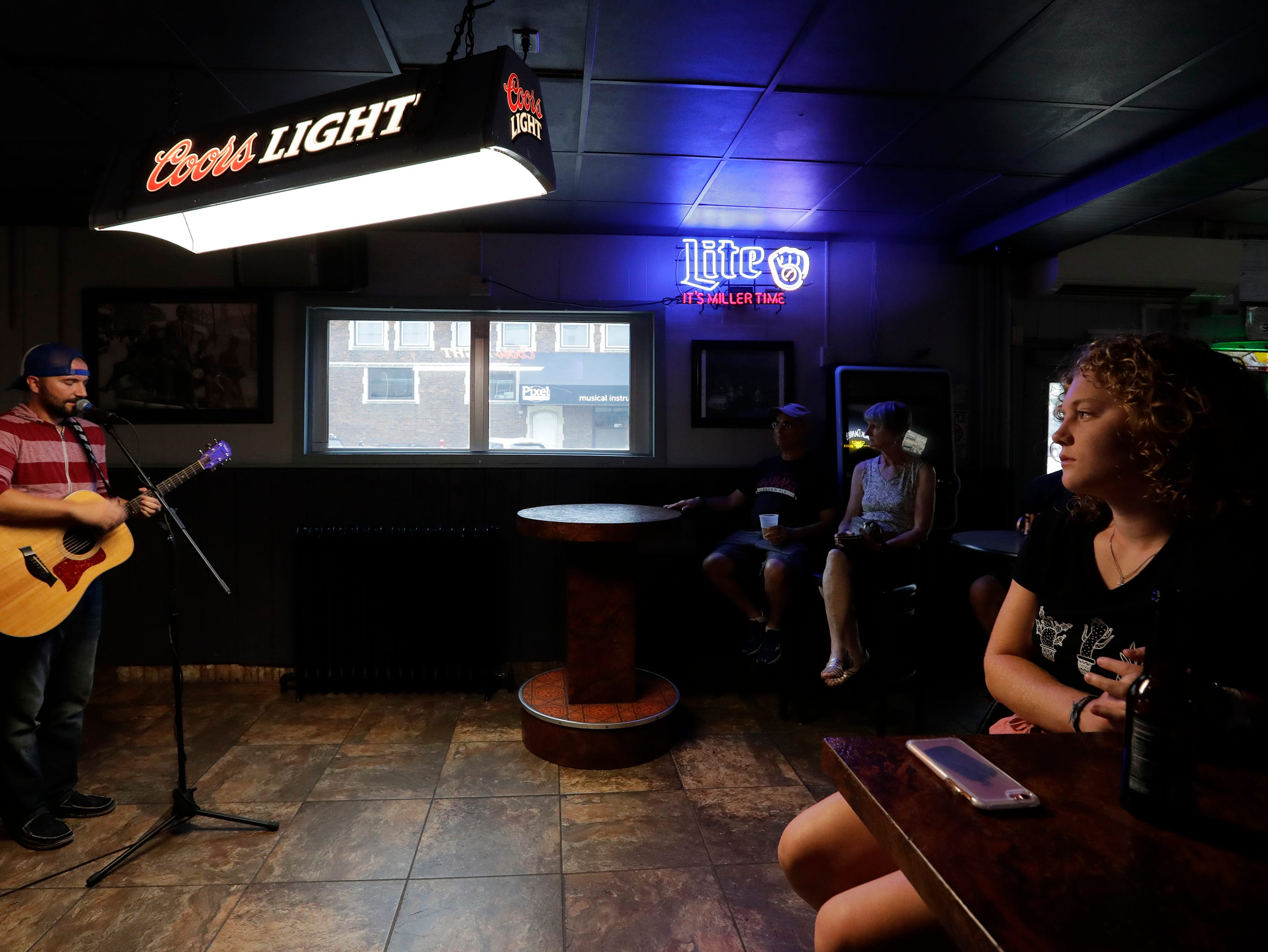 Jacob Fannin performs at Jacks Apple Pub during the Mile of Music Friday, August 3, 2018, in Appleton, Wis.  