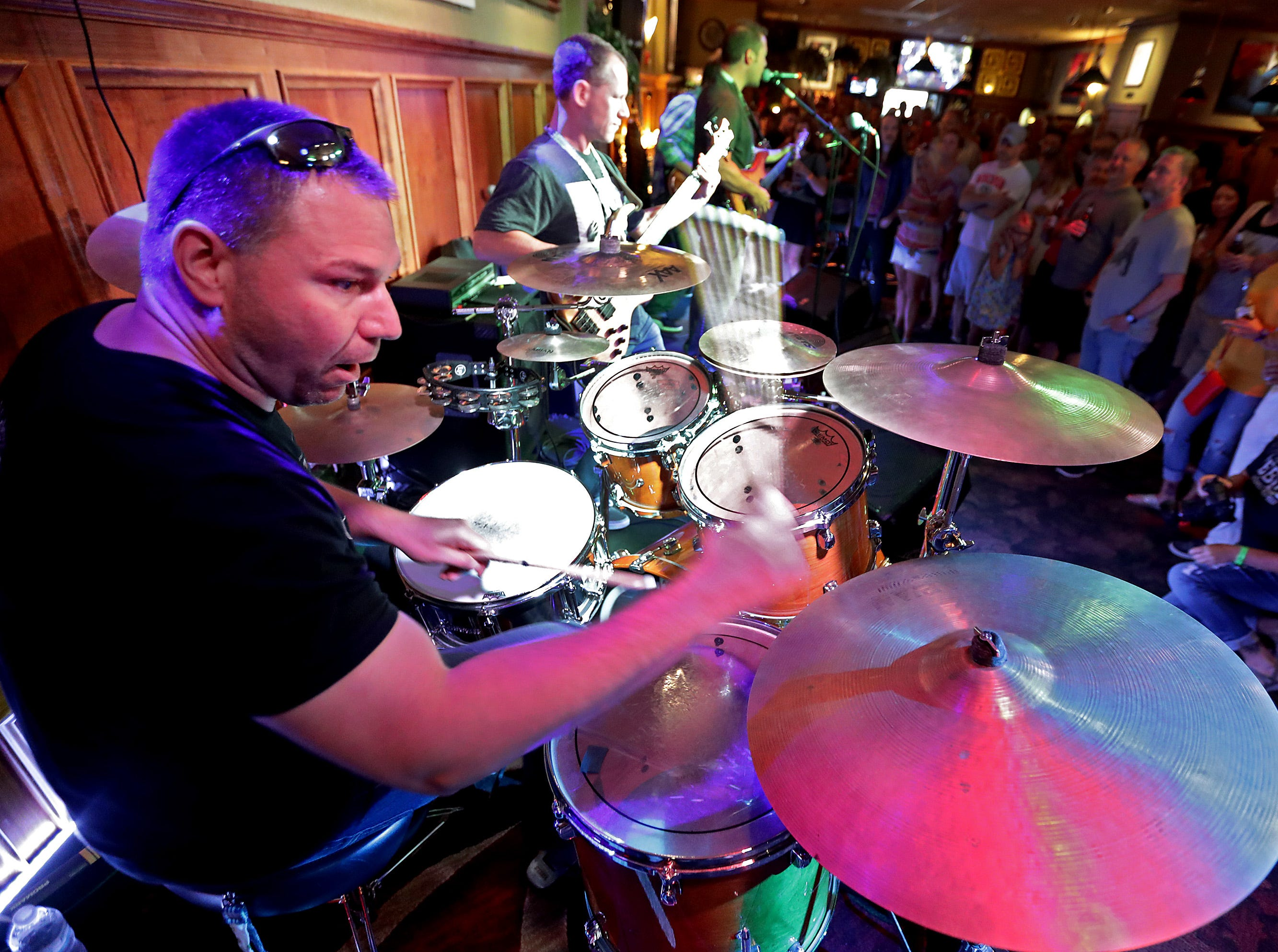 Greg Ashauer plays with BlackBelt YellowBelli at the Deja Vu Lounge during the Mile of Music festival Friday, August 3, 2018, in Appleton, Wis. 