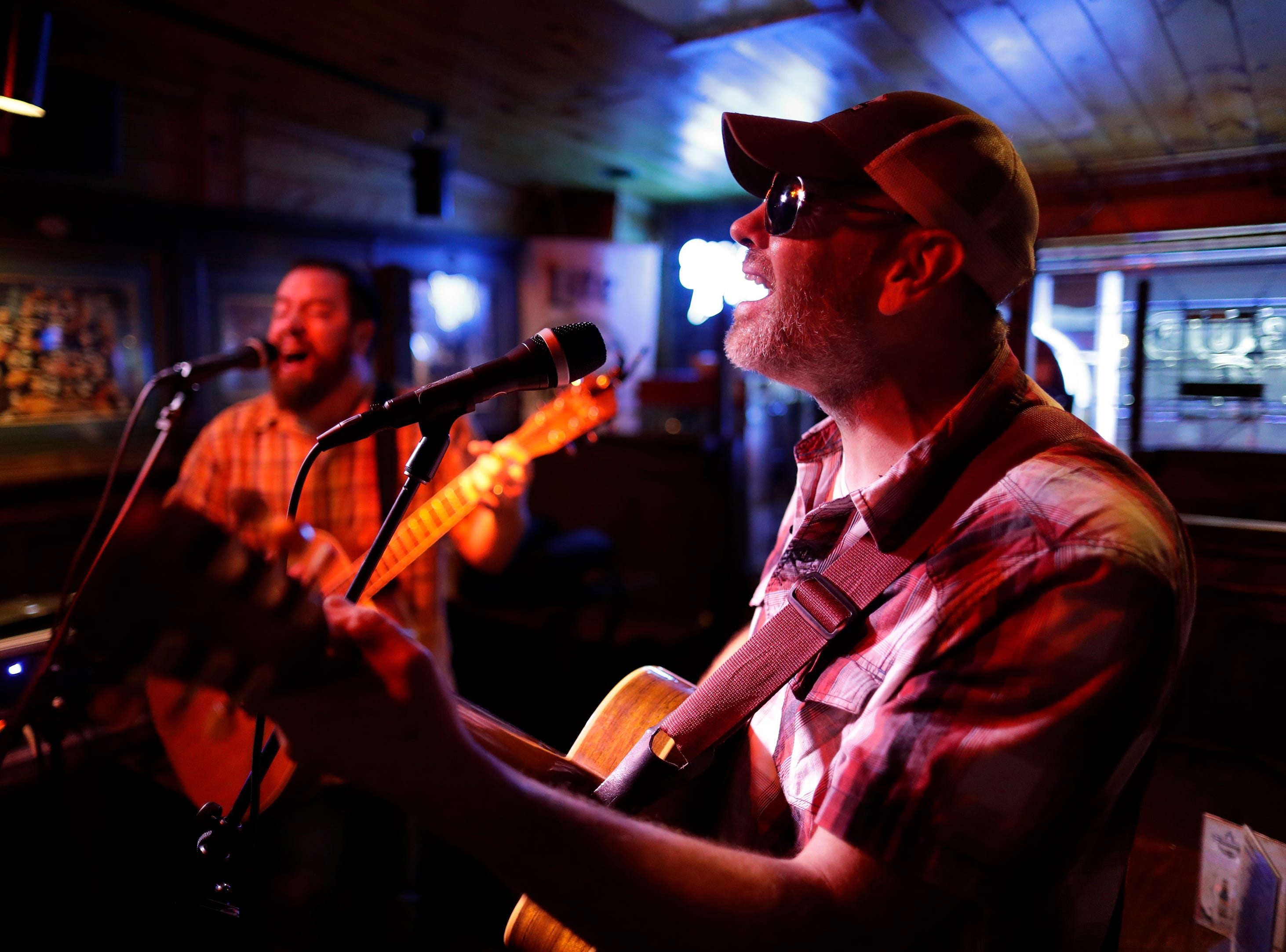 Leading The Blind acoustical performs at the Wooden Nickel during the Mile of Music Friday, August 3, 2018, in Appleton, Wis.  