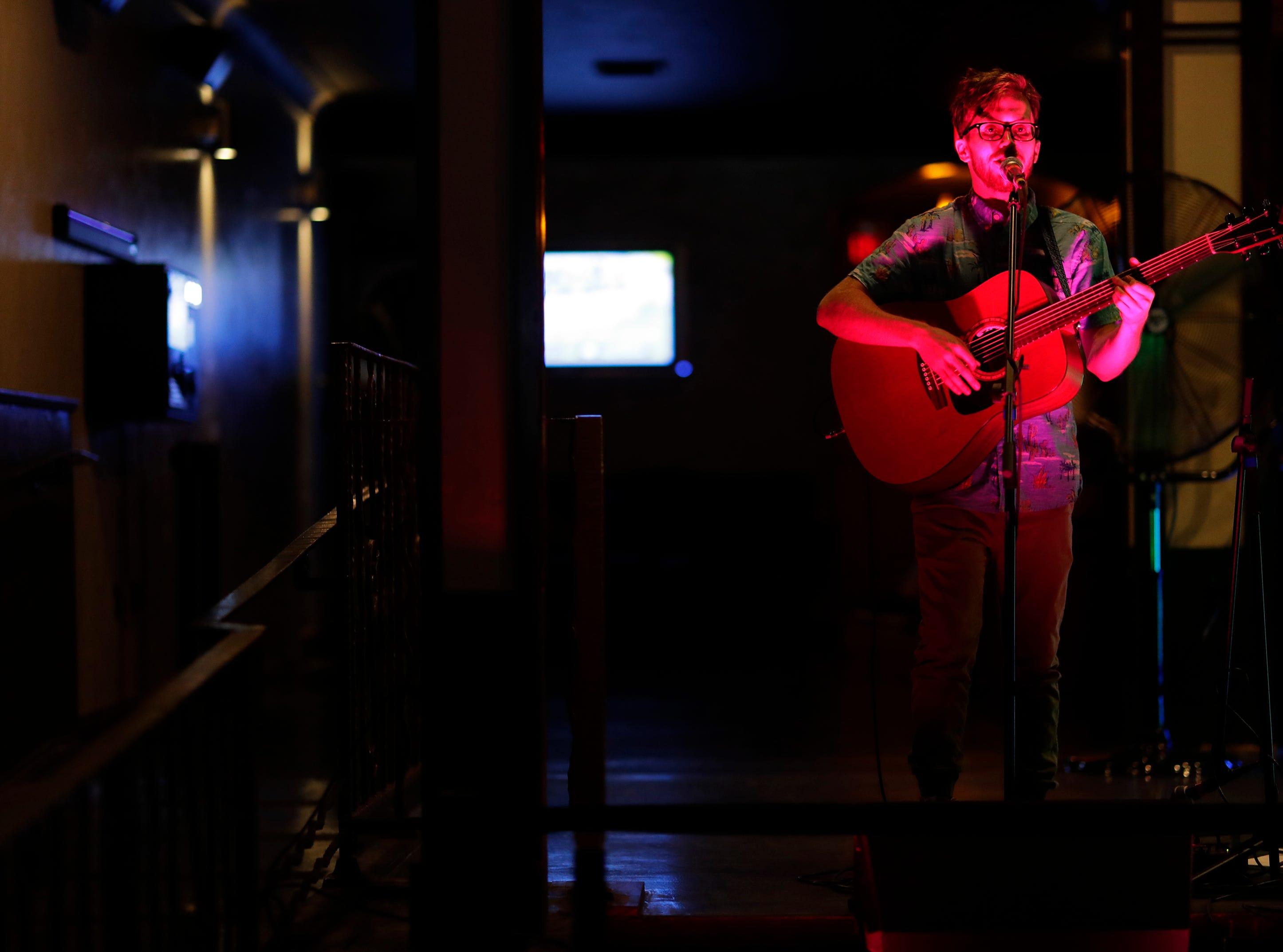 David Paul Martin performs at the Speakeasy Ultra Lounge during the Mile of Music Friday, August 3, 2018, in Appleton, Wis.  