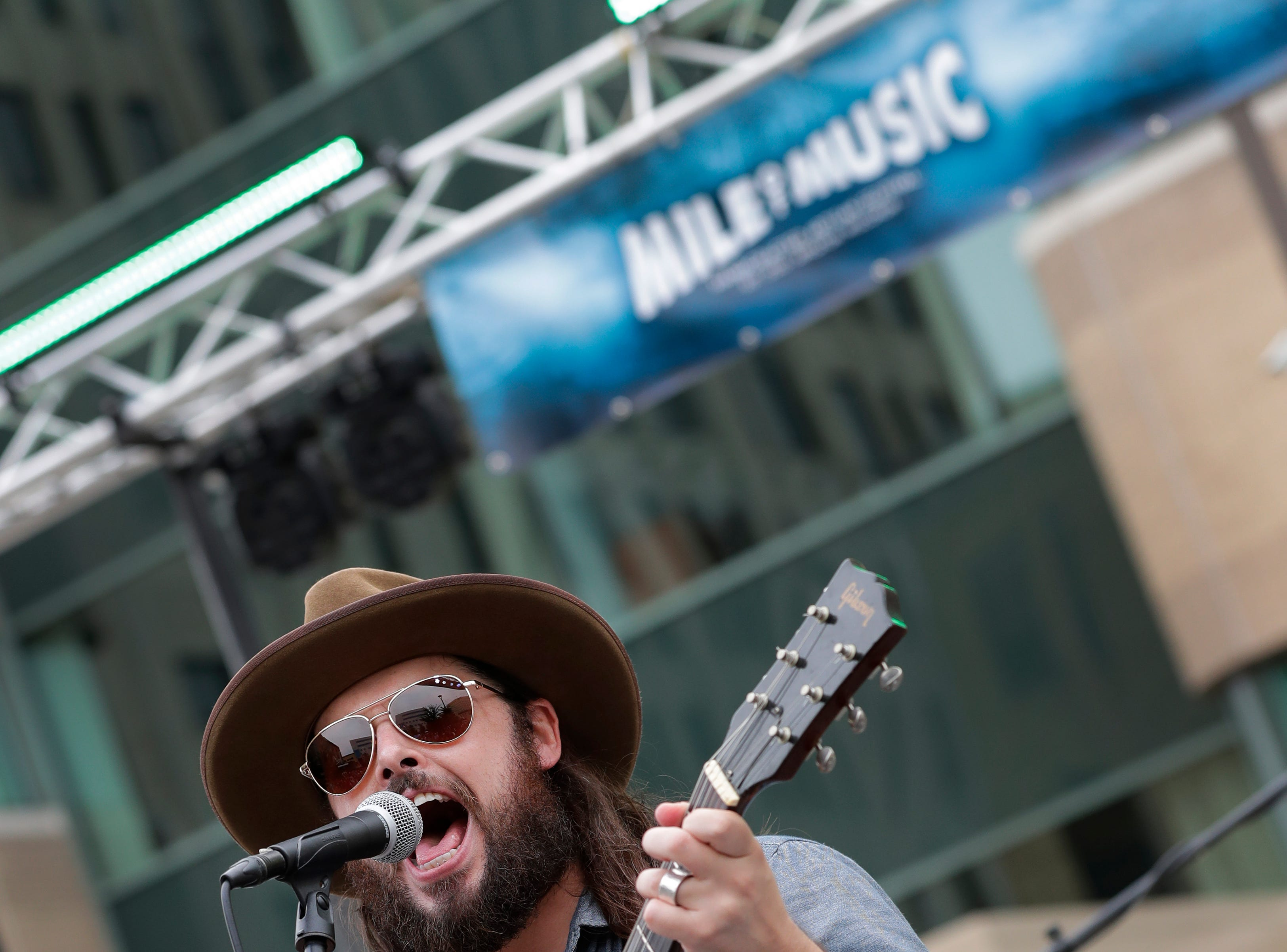 Caleb Caudle performs at the Houdini Plaza during the Mile of Music Friday, August 3, 2018, in Appleton, Wis.  