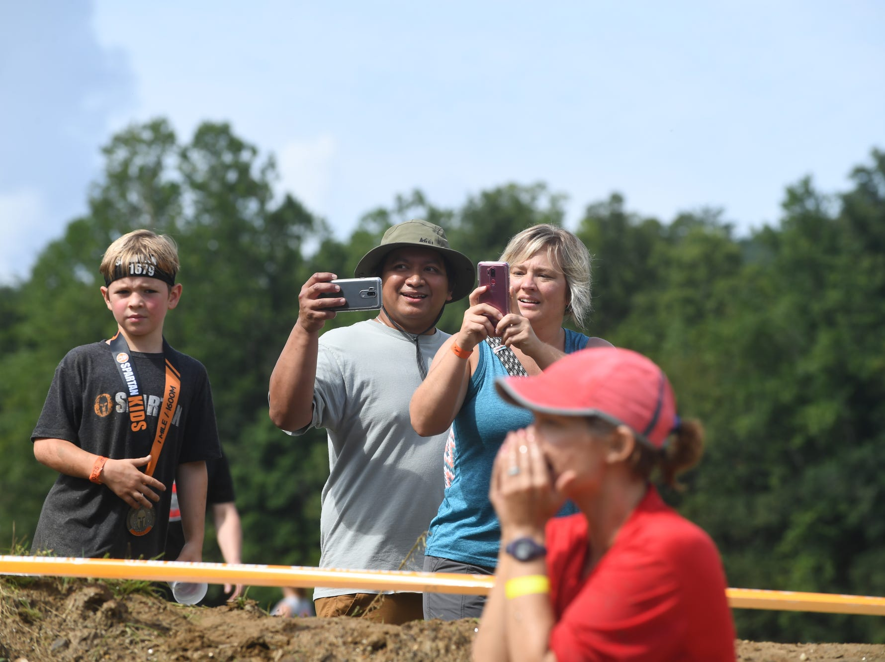 Every 15 minutes, more than 250 racers entered the Spartan obstacle course to test their athleticism in a muddy cow pasture on North Fork Left Fork Road in Black Mountain Saturday.