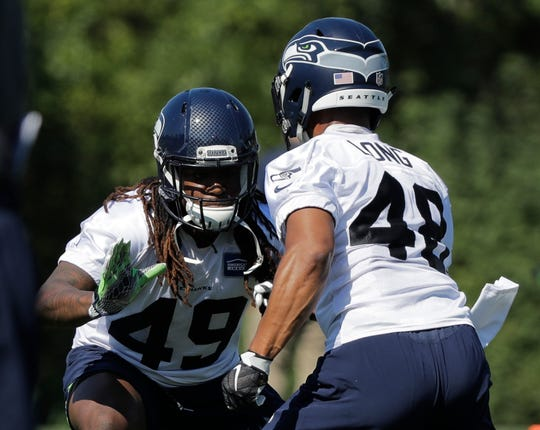 Seattle Seahawks linebacker Shaquem Griffin, left, lines up against linebacker Warren Long, right, during a recent training camp session in Renton.