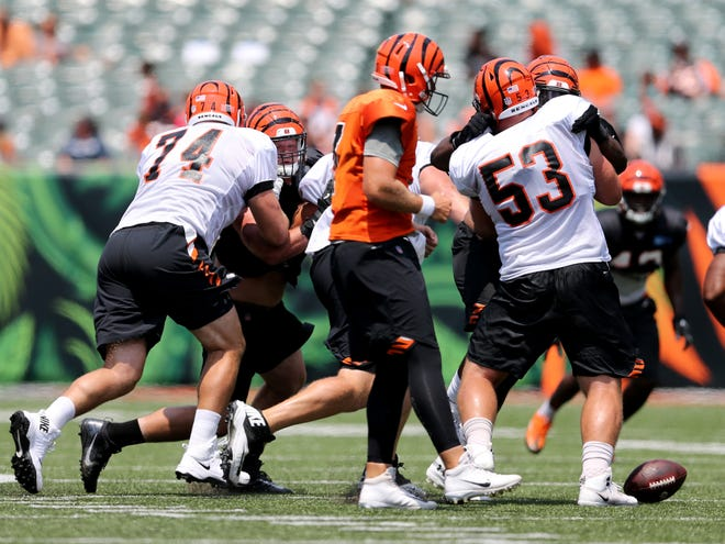 Cincinnati Bengals center Billy Price (53) blocks after a bad snap with quarterback Matt Barkley (7) during Cincinnati Bengals training camp practice, Saturday, Aug. 4, 2018, at Paul Brown Stadium in Cincinnati.