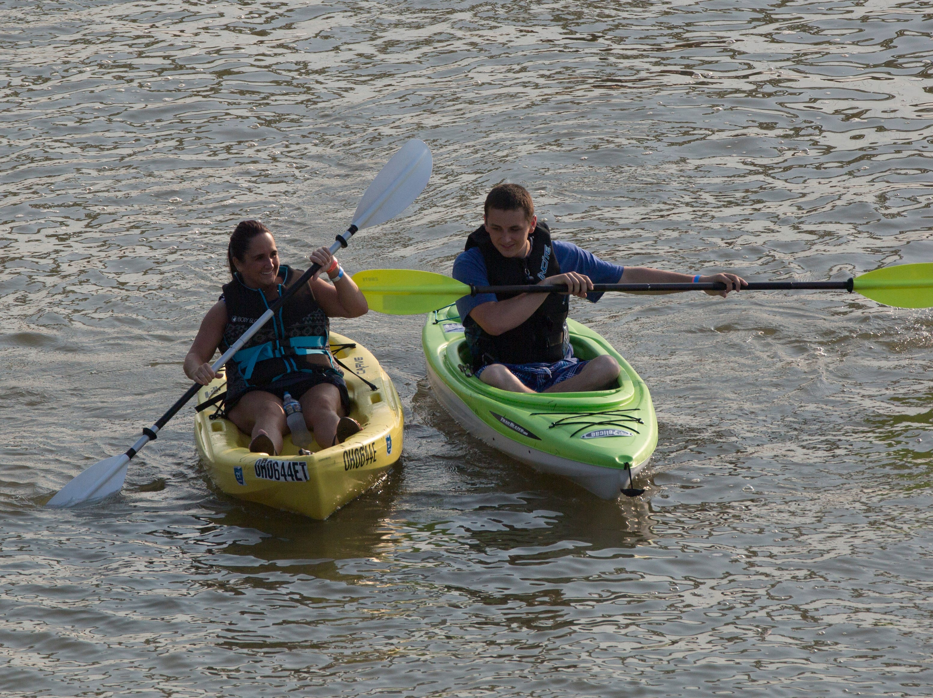 People kayaks down the Ohio River during the 17th annual Ohio River Paddlefest in Cincinnati on Saturday, Aug. 4, 2018.  According to organizers about 2000 people participated in the event which Outdoor Adventure Clubs of Greater Cincinnati raised almost $100,000.