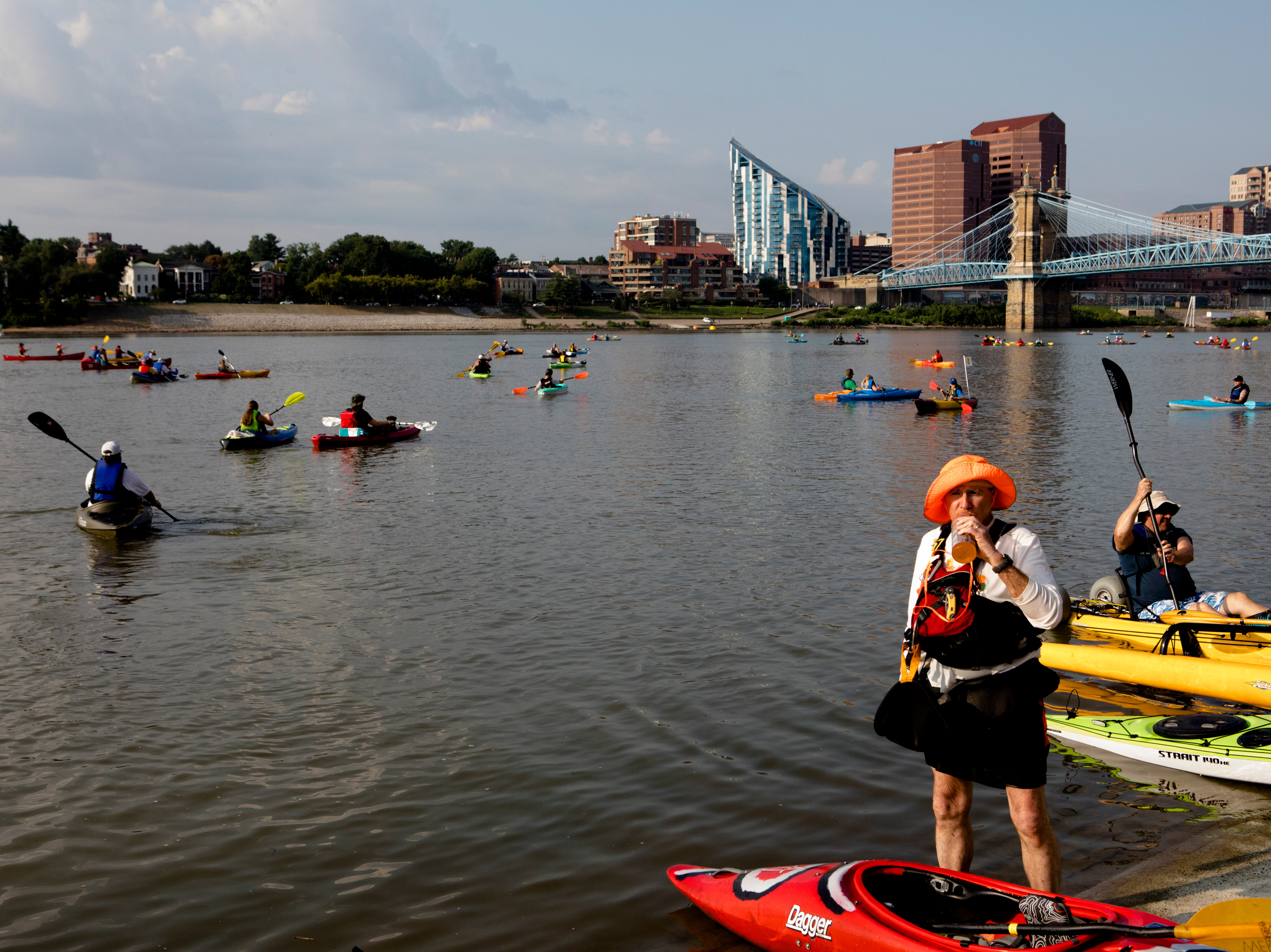 Tim Kling takes a drink of gatorade during the 17th annual Ohio River Paddlefest in Cincinnati on Saturday, Aug. 4, 2018.  According to organizers about 2000 people participated in the event which Outdoor Adventure Clubs of Greater Cincinnati raised almost $100,000.