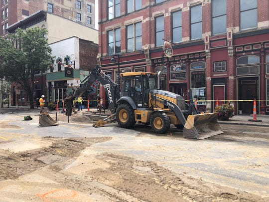 Cleanup begins on Fourth Avenue after water main breaks caused flooding following the Downtown Farmers' Market in Des Moines.
