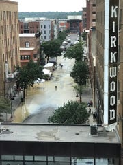 Water floods part of Fourth Street in Des Moines on Saturday, Aug. 4, 2018.