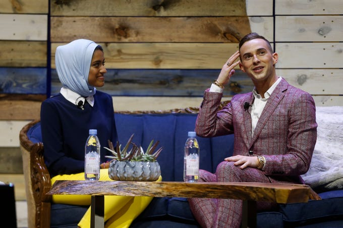 "Olympic figure skater Adam Rippon (right) jokes with WHBF-TV reporter and moderator Tahera Rahman Saturday, Aug. 4, 2018, during his panel on ""Being My True Self"" at Newbo Evolve in Cedar Rapids, Iowa. The new festival featured music, art and inspirational speakers over three days."