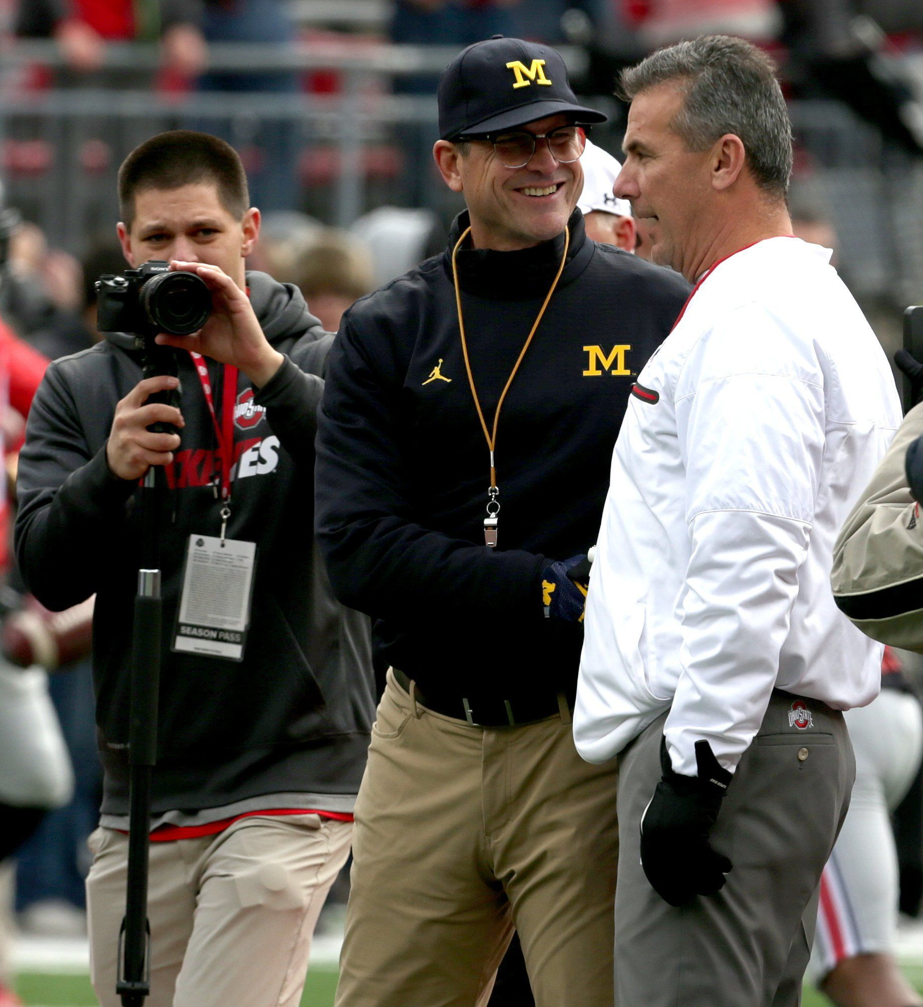 Jim Harbaugh and Urban Meyer shake hands before the game at Ohio Stadium in Columbus, Ohio on Nov. 26, 2016.
