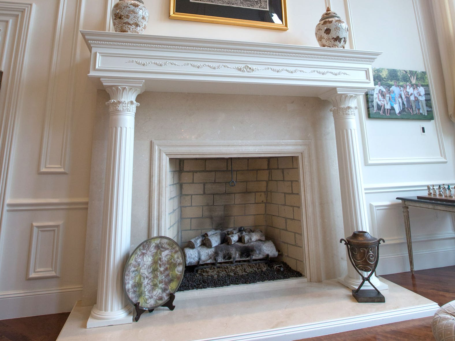 The owners designed the white marble fireplace, keeping the theme of pillars. The house has five fireplaces.