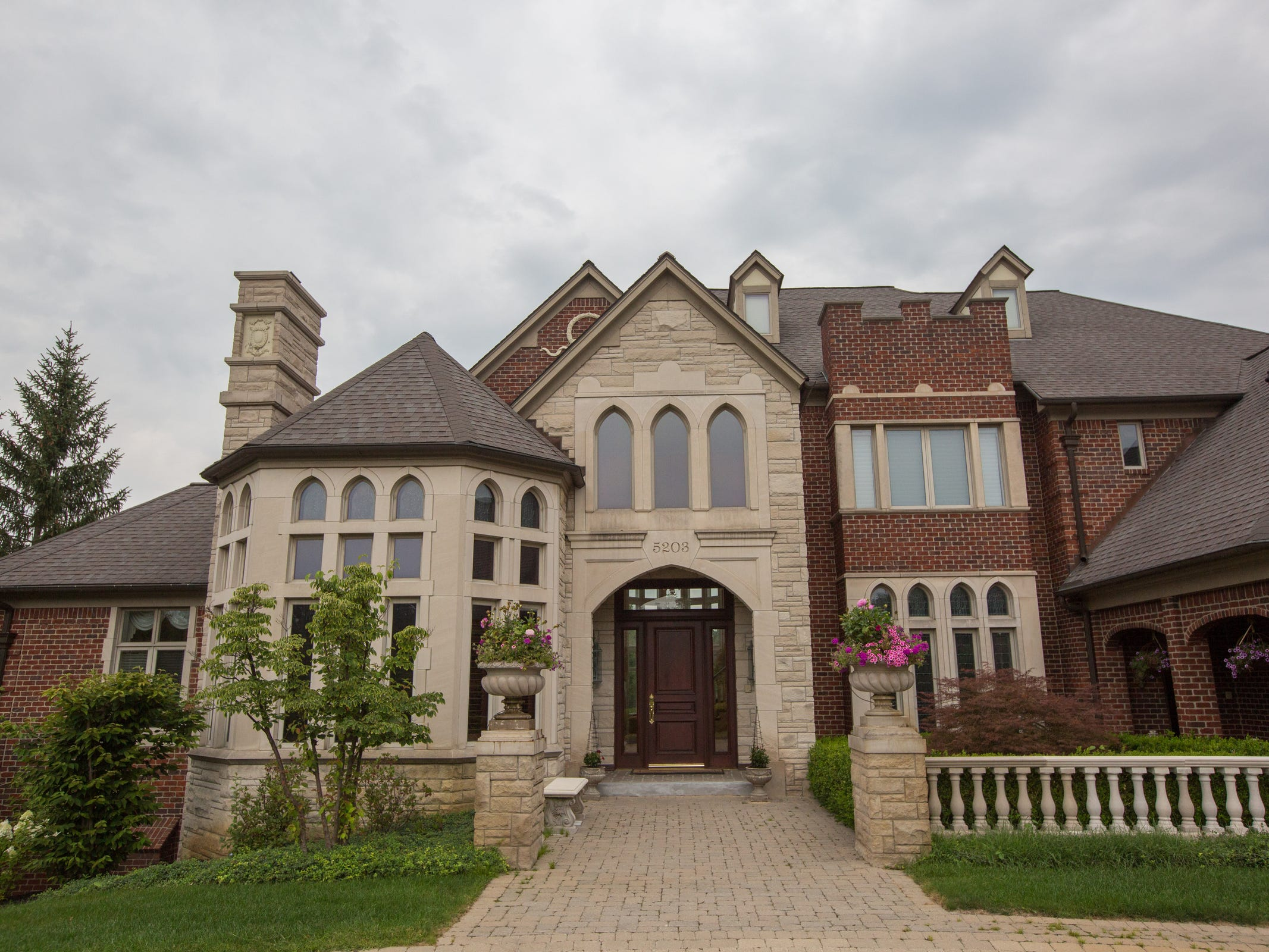 Carved limestone trim, limestone walls and stone balustrades are part of the rich, traditional exterior.