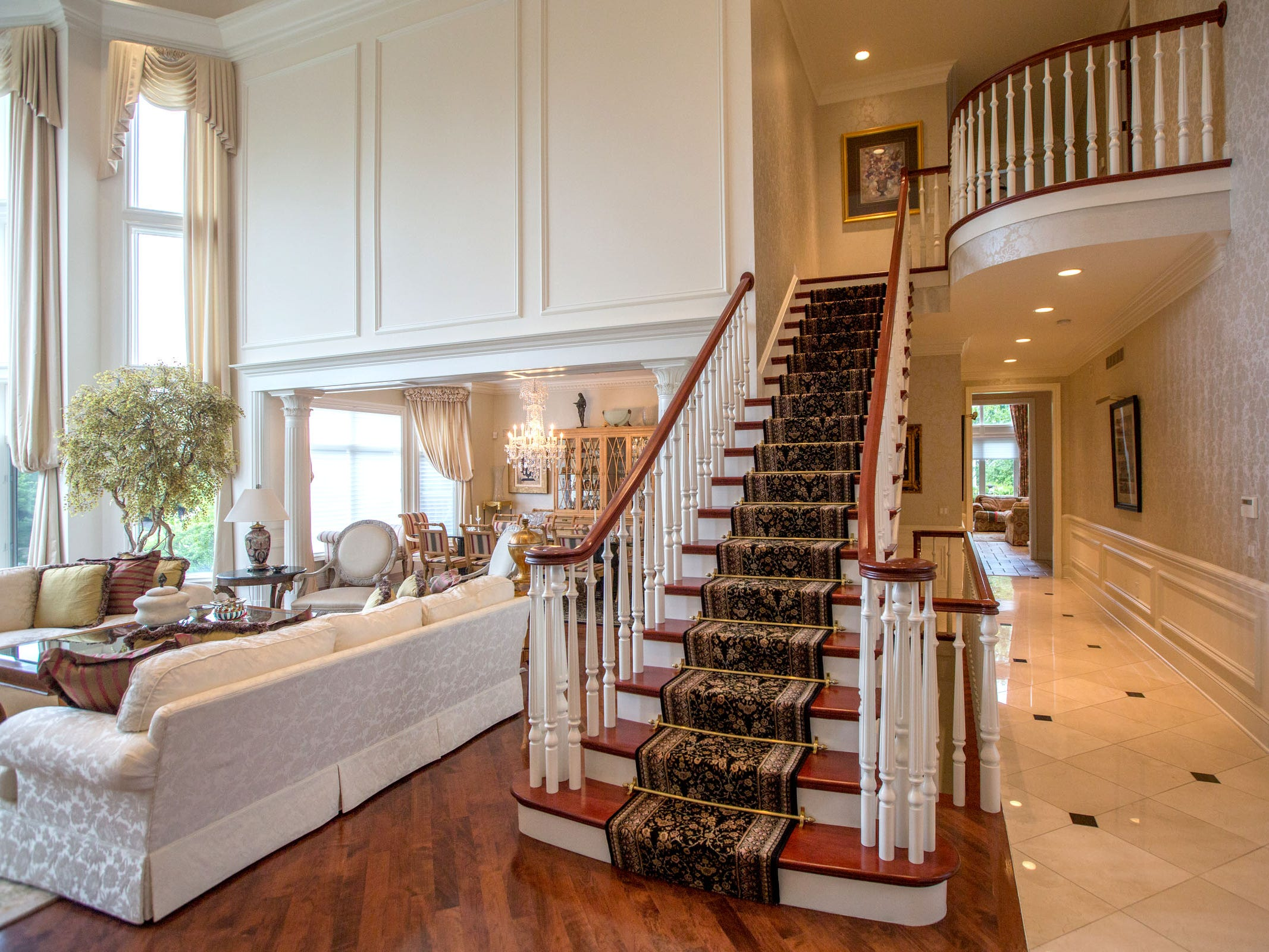 """It has four staircases that may remind you of a line from """"Fiddler On the Roof."""" """"Two staircases go up,"""" the owner said, """"to reach the second floor, and two more go down to the lower party level."""""""