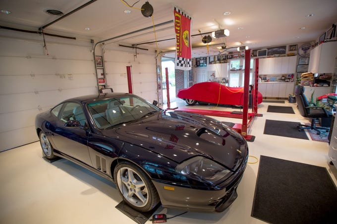 """This garage is featured in the book """"Motor City Garages -- Amazing Collections From America's Greatest Car City."""" A 1999 Ferarri Maranello 550 is in one of the bays of the six-car garage."""
