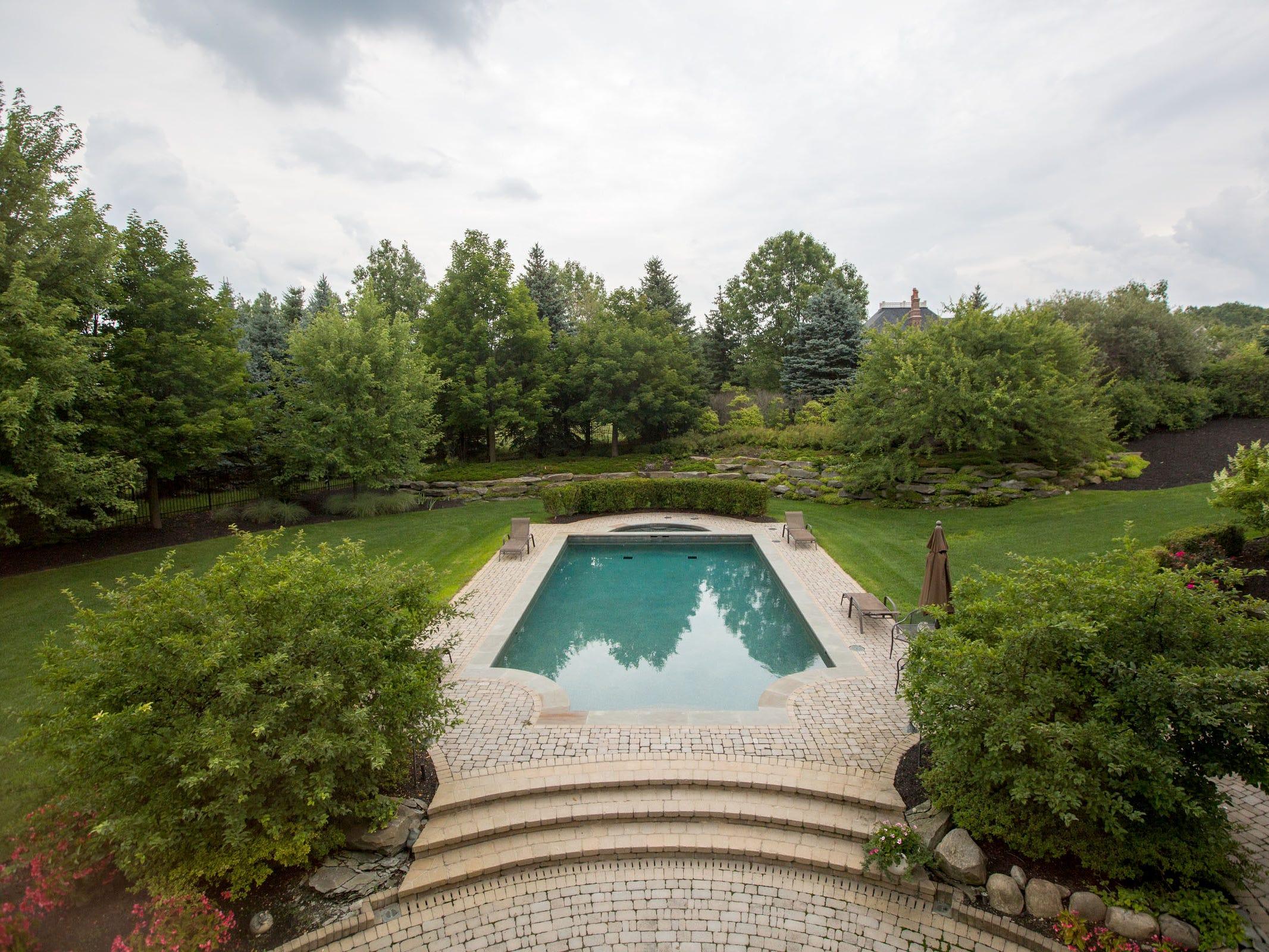 Belgian brick surrounds the pool.
