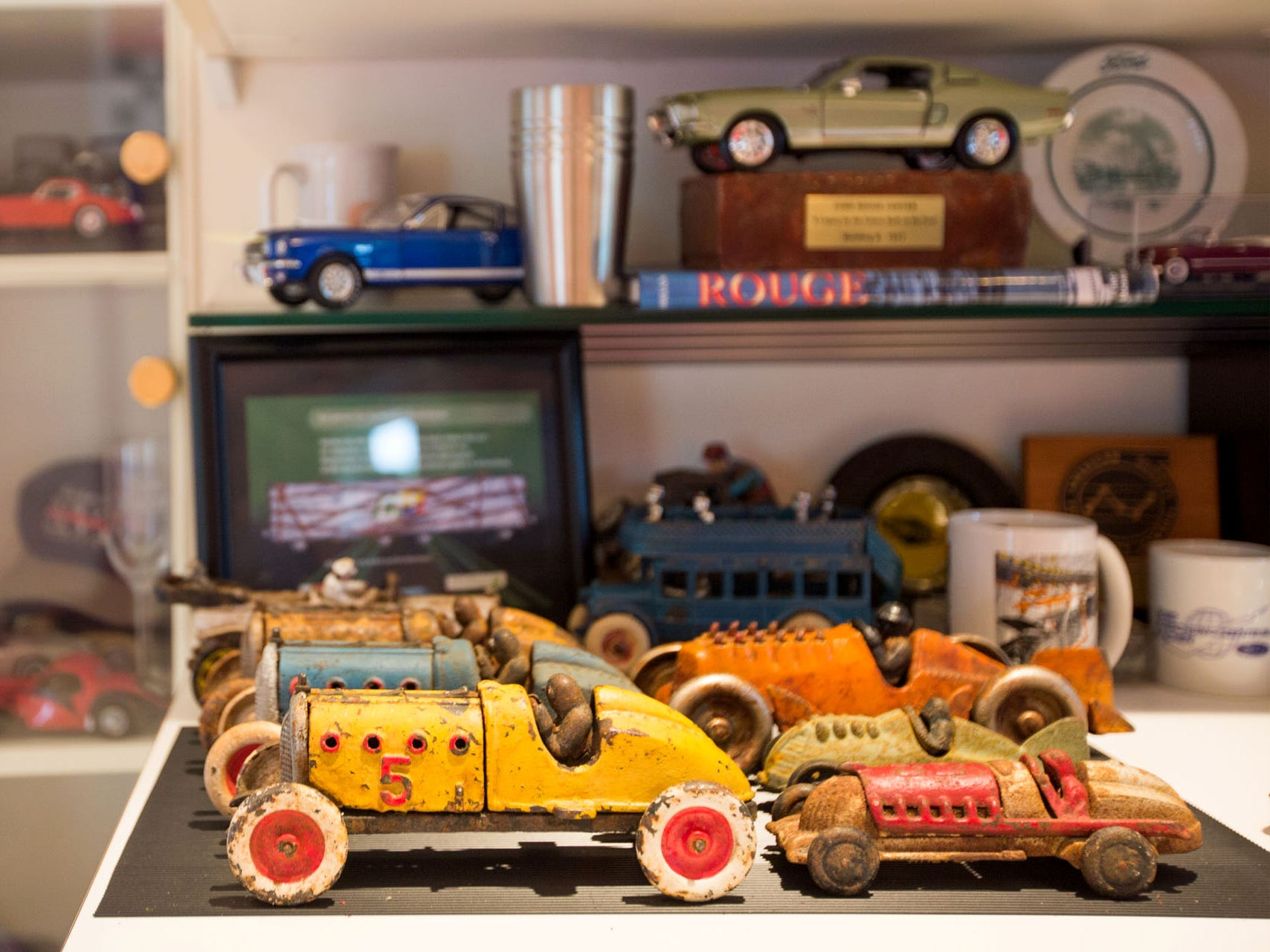 Garage display space shows car models the owner's been making since a child. He also does lavish restorations of antique children's pedal cars, including a highly detailed Lincoln Dual Cowl Phaeton six-wheel design