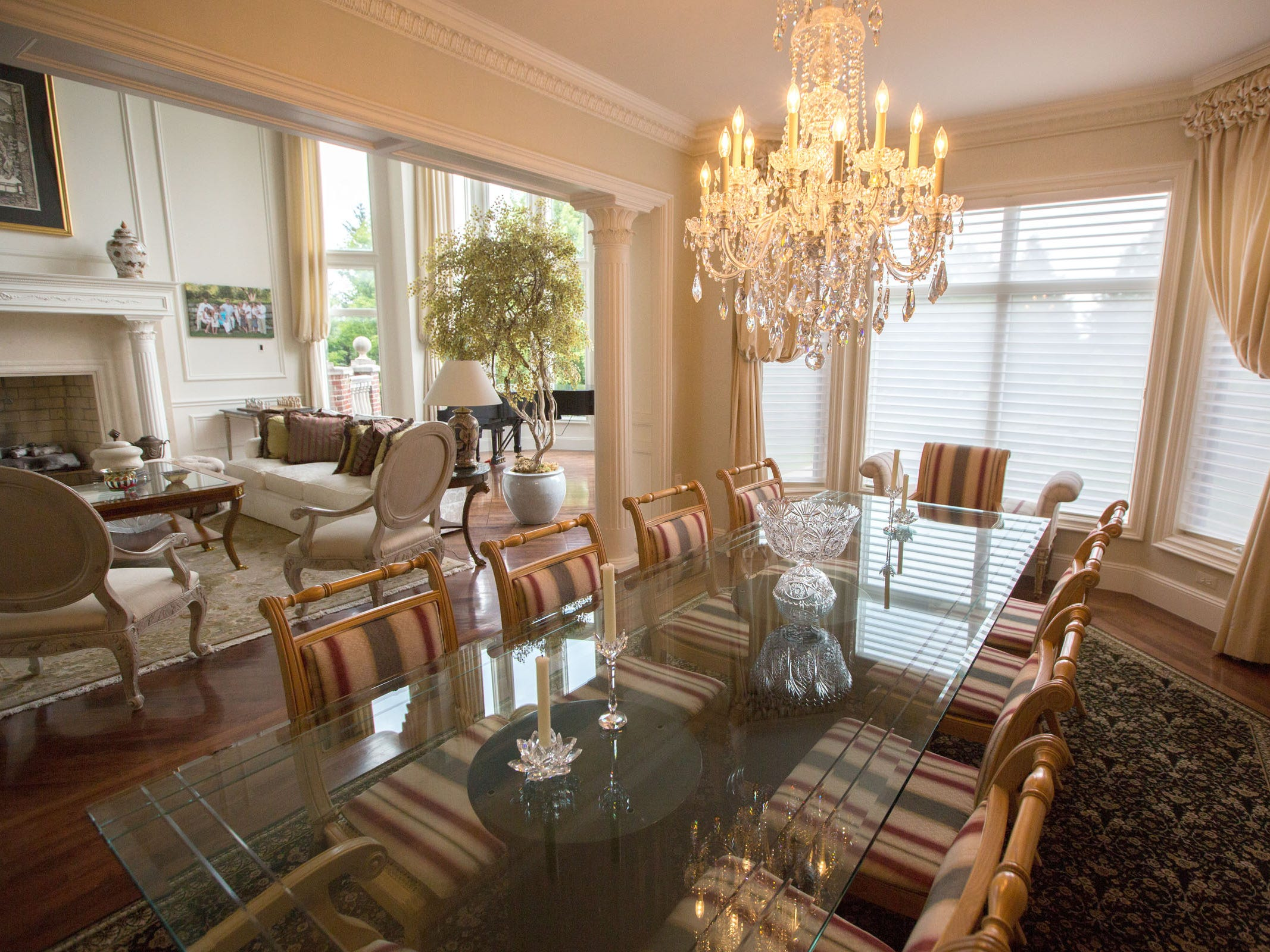 View from the formal dining room into the living room. The wood floors are cherry.